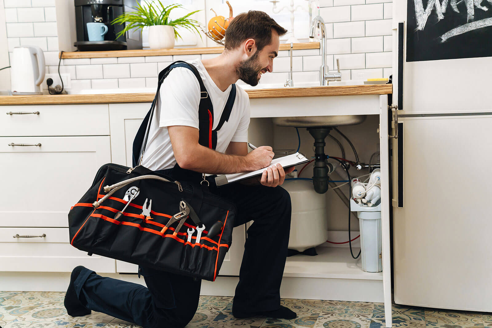 plumber man with equipment and checklist for new home