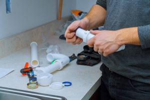 plumber-fitting-pipes-of-tools-and-equipment