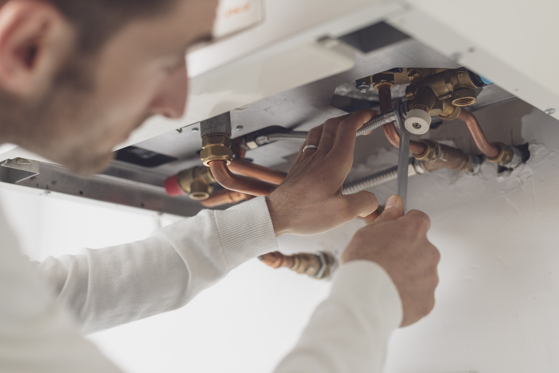 Plumber working on a hot water system