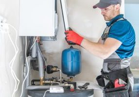 plumber installing gas hot water system